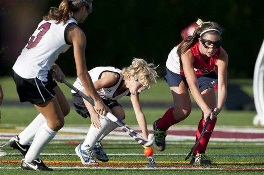 In an Oct. 21, 2011 photo, Keeling Pilaro, center, goes for the ball as a member of the Southhampton High School Girls' Varsity field hockey team during a game against Miller Place in Southhampton, N.Y. Pilaro has been told he can no longer play on the girls' field hockey team because he is now too skilled to qualify for an exemption allowing him to compete with, and against, girls next season. Associated Press Photo: AP / Newsday