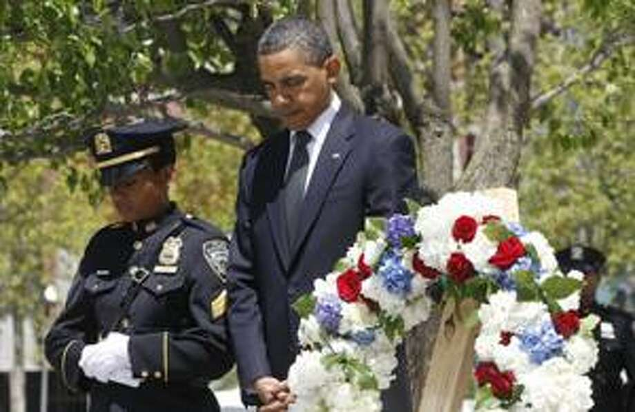 President Barack Obama pauses after laying a wreath at the National Sept. 11 Memorial at Ground Zero in New York, Thursday, May 5, 2011. (AP Photo/Charles Dharapak) Photo: ASSOCIATED PRESS / AP2011