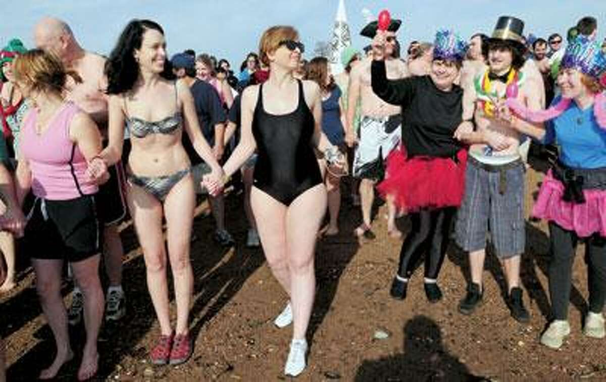 Participants prepare to run into the Long Island Sound for the 11th annual Polar Plunge for Parks, Community Gardens, and Environmental Groups at Lighthouse Point Park in New Haven on New Year's Day. (Arnold Gold/Register)