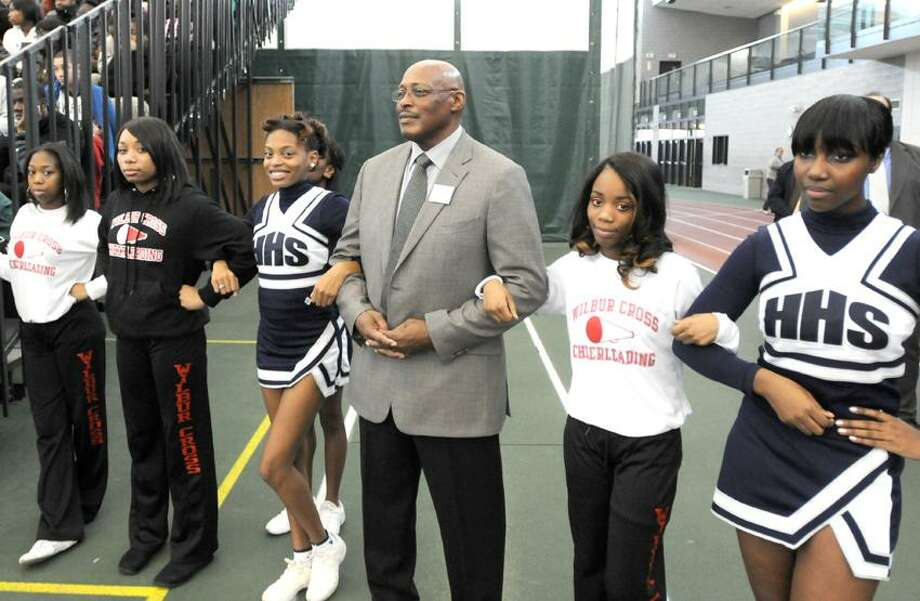 Floyd Little, former Hillhuse High School All-State Player and NFL Hall of Famer, waits with New Haven Public Schools cheerleaders before his introduction during the Walter Camp Football Foundation sponsored 17th annual Stay In School Rally 1/12/12 at the Floyd Little Athletic Center in New Haven.   Photo by Peter Hvizdak / New Haven Register January 12, 2012       ph2438                 Connecticut / PETER HVIZDAK