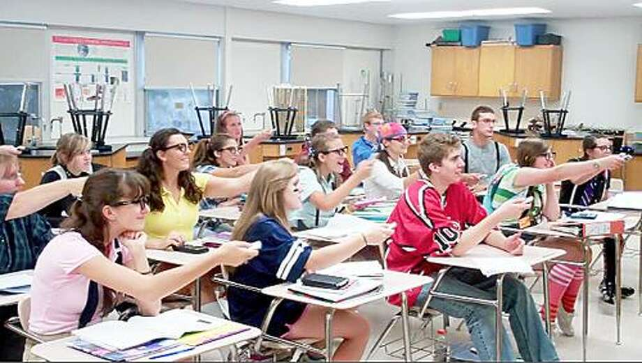 """Photos Courtesy BETH CARPENTER Students in Elizabeth Carpenter's physics class perform """"Do Our Best,"""" a video parody of """"Be Our Guest"""" from """"Beauty and the Beast,"""" in an attempt to win a contest that will put more technology in the classroom."""