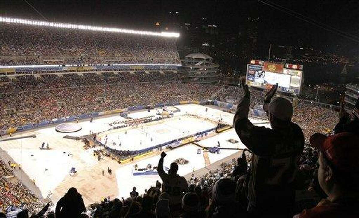Fans applaud a penalty call in the first period at Heinz Field in the NHL Winter Classic outdoor hockey game between the Washington capitals and the Pittsburgh Penguins in Pittsburgh on Saturday, Jan. 1, 2011. (AP Photo/Keith Srakocic)