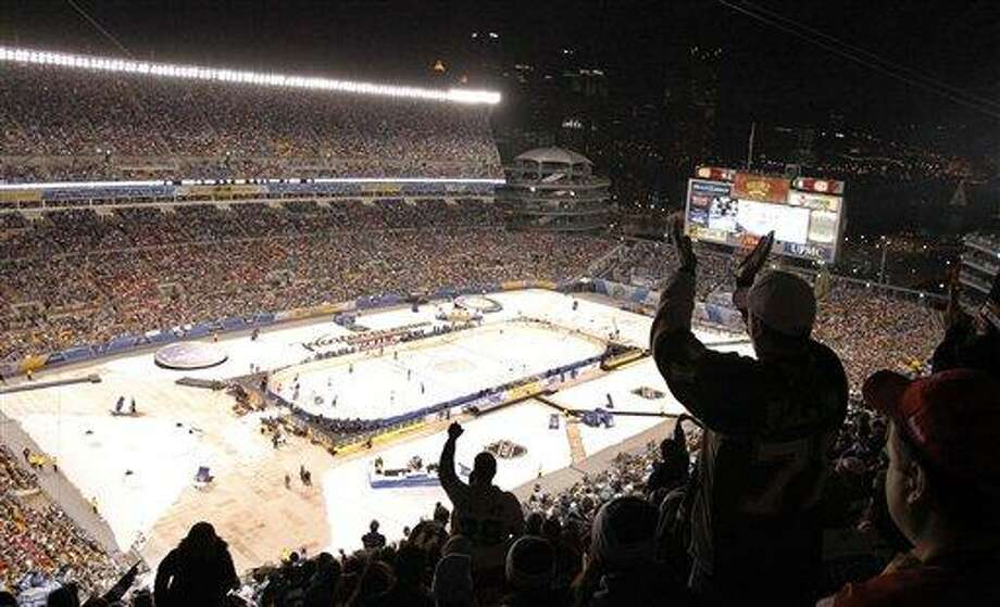 Fans applaud a penalty call in the first period at Heinz Field in the NHL Winter Classic outdoor hockey game between the Washington capitals and the Pittsburgh Penguins in Pittsburgh on Saturday, Jan. 1, 2011. (AP Photo/Keith Srakocic) Photo: AP / AP
