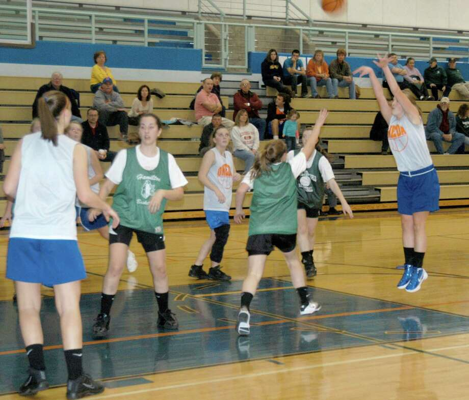 Dispatch Staff Photo by DAVID M. JOHNSONOneida and Hamilton's girls basketball teams scrimmage on Monday, November 28, 2011 in Oneida.