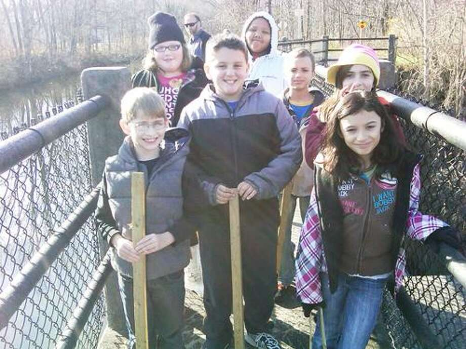 Photo Courtesy ONEIDA KIDS CLUB Members of the Oneida Kids Club helped clean up the Erie Canal Towpath in Oneida.