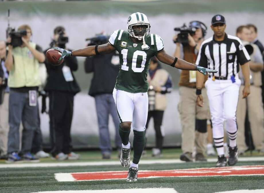 New York Jets wide receiver Santonio Holmes (10) reacts after scoring during the fourth quarter of an NFL football game against the Buffalo Bills on Sunday, Nov. 27, 2011 in East Rutherford, N.J. The Jets won 28-24. (AP Photo/Bill Kostroun) Photo: AP / FR51951 AP