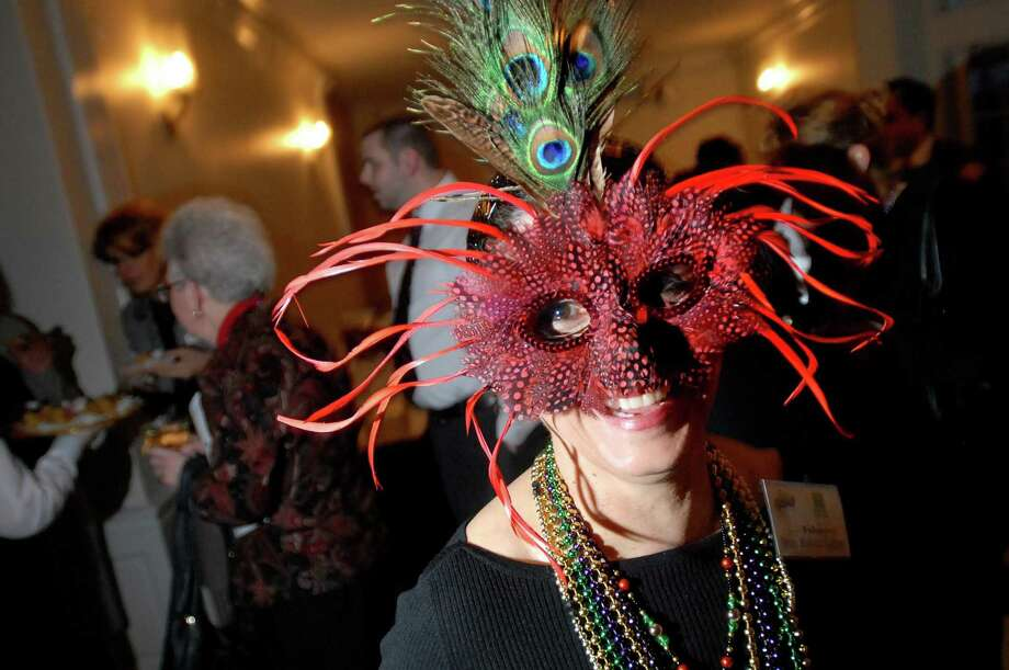 In this Register file photo, Librarian Nancy Moscoso-Guzman wears a mask for the New Haven Free Public Library Mardi Gras Gala and Silent Auction and 122nd Birthday Celebration at the New Haven Lawn Club in 2009. Photo by Arnold Gold    AG0300C