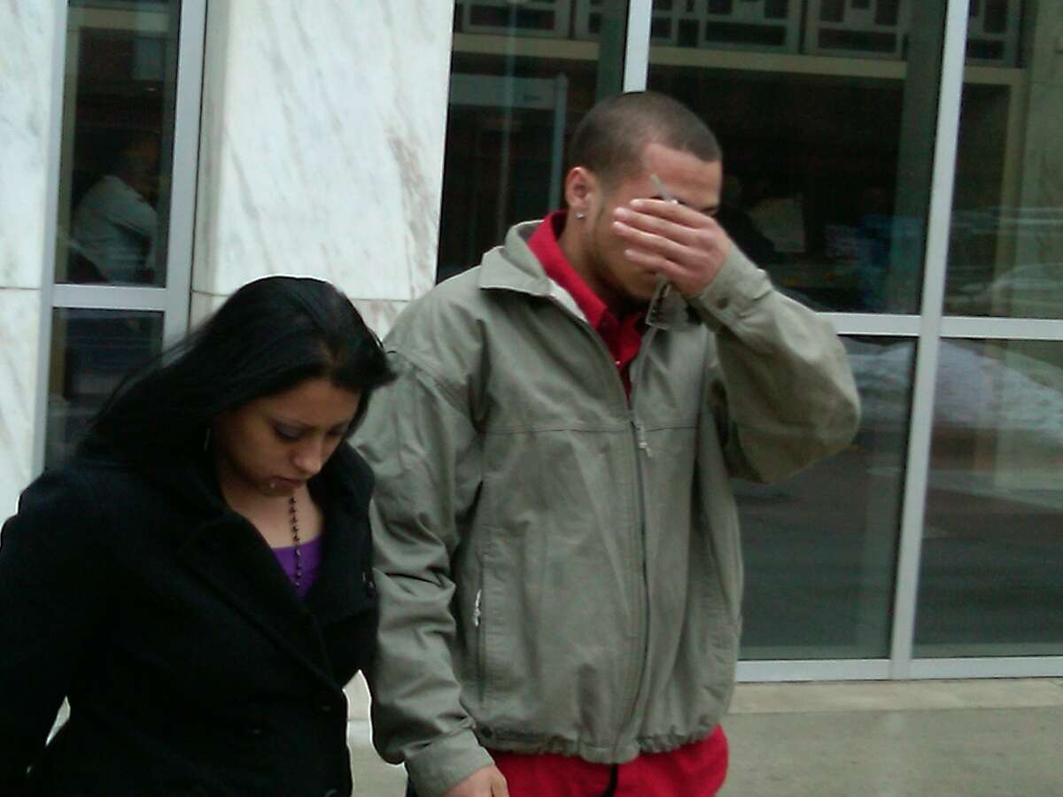 Osvaldo Segui Jr., who pleaded guilty Monday in federal court in an arson-for-hire blaze that destroyed a Fair Haven Laundromat. The woman at left identified herself only as friend. Photo by William Kaempffer