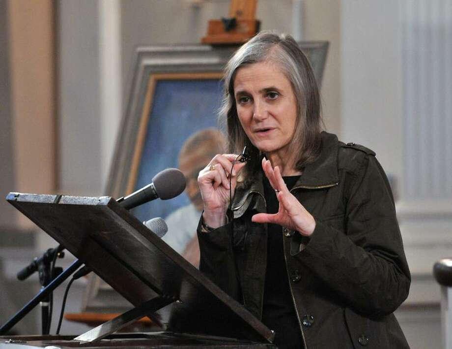 "Amy Goodman, host of the ""Democracy Now!"" show speaks to the crowd at the United Church on the Green. Peter Casolino/New Haven Register"