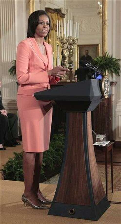 First lady Michelle Obama delivers remarks in the East Room of the White House in this April 2011 file photo to launch Joining Forces, the national initiative to support and honor America's service members and their families. Mrs. Obama is expected to announce a commitment to improved veterans' treatment from more than 100 medical schools during an appearance Wednesday at Virginia Commonwealth University in Richmond.  Associated Press Photo: AP / AP2011