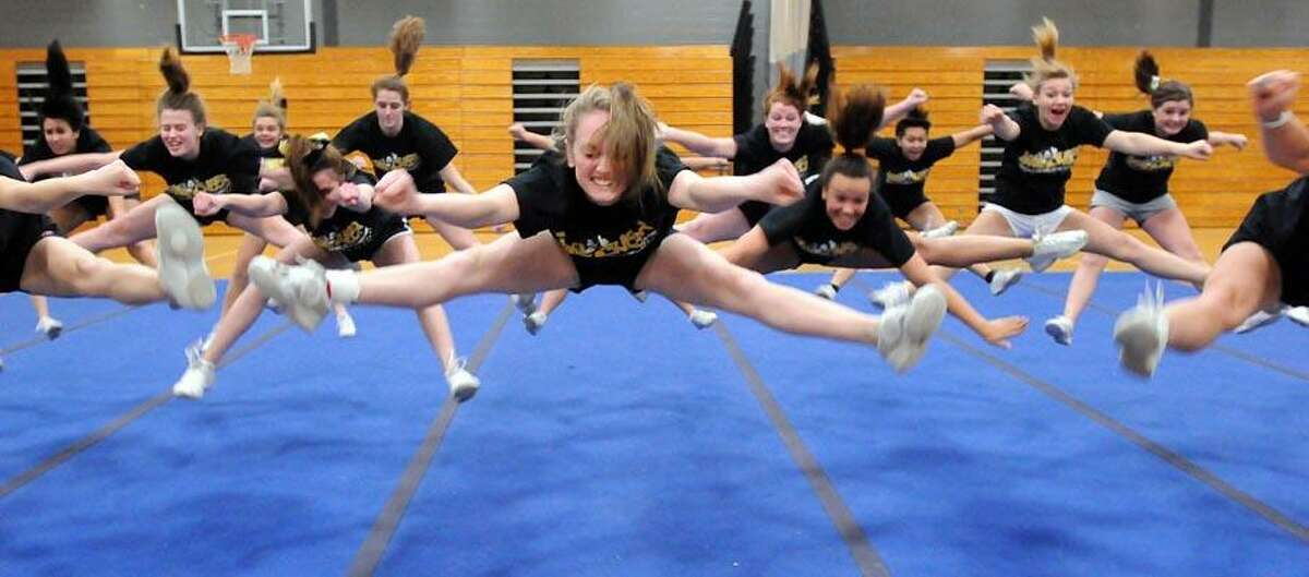 The Law High School (Milford) cheerleading squad in action. They won a third place in a national competition. Photo by Mara Lavitt/New Haven Register2/24/11