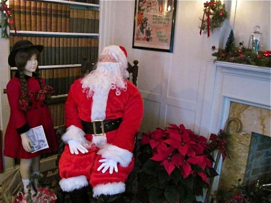 "Mannequins representing a little girl and Santa Claus depict a scene from the 1947 movie classic, ""Miracle on 34th Street,"" at the Osborne Homestead Museum in Derby. The house is decorated and open for tours during the holiday season. Patricia Villers/Register"