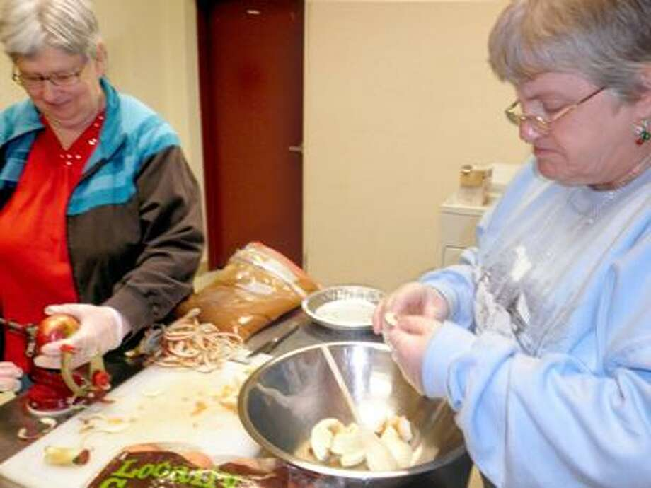 Photo Courtesy MADISON-CORTLAND ARC Colleen Hall, left, and Rosalie Leggett, who attend the Madison Cortland ARC Senior Program, were busy making apple pies for the Senior Program Thanksgiving Dinner. / MCARC Oneida NY