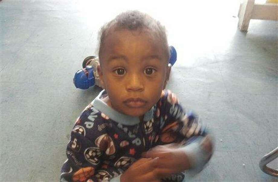 In this Nov. 25, 2011 photo provided by the Columbia S.C., Police Dept., 18-month-old Amir Jennings is shown near Columbia, S.C. Investigators might have had no leads on a missing mother and child if the woman hadn't crashed her car on Christmas Eve. But even after questioning Zinah Jennings in custody, police don't know what's happened to her son. She is now in jail, charged with lying to authorities about where the boy is, prompting a search by local, state and federal authorities spanning the Carolinas, Georgia and beyond.  (AP Photo/Columbia S.C., Police Dept.) Photo: AP / Columbia S.C., Police Department