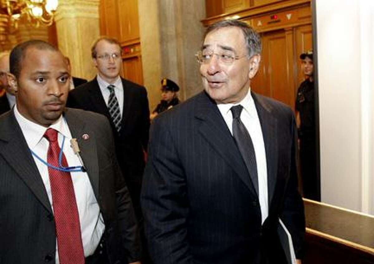 AP Photo CIA Director Leon Panetta, right, leaves after briefing members of Congress on Capitol Hill Tuesday, May 3, 2011 in Washington.