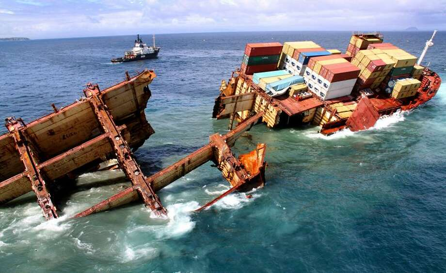 In this photo provided by Maritime New Zealand, half of the cargo ship Rena sinks on a reef near Tauranga, New Zealand, Tuesday. The 774-foot vessel split in two over the weekend amid heavy seas and now the stern section is slipping from the Astrolabe reef and sinking. Associated Press Photo: ASSOCIATED PRESS / AP2012