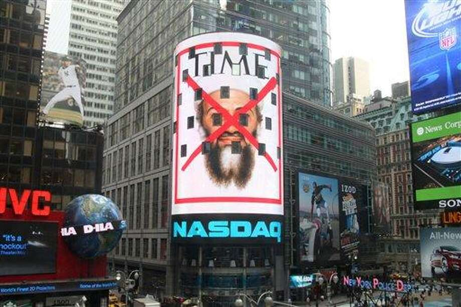 """This photo, provided by NASDAQ OMX Group, shows the cover of a special issue of Time magazine on the death of Osama bin Laden displayed on the Nasdaq screen in New York's Times Square. The issue, featuring a red """"X"""" over bin Laden's face, will hit newsstands on Thursday, May 5, 2011. The magazine says it is the fourth cover in TIME's history to feature the red """"X."""" Other covers showed Adolf Hitler on May 7, 1945, Saddam Hussein on April 21, 2003, and Abu Musab al-Zarqawi on June 19, 2006. (AP Photo/NASDAQ OMX Group, Inc.) Photo: AP / NASDAQ OMX Group, Inc. 2011"""