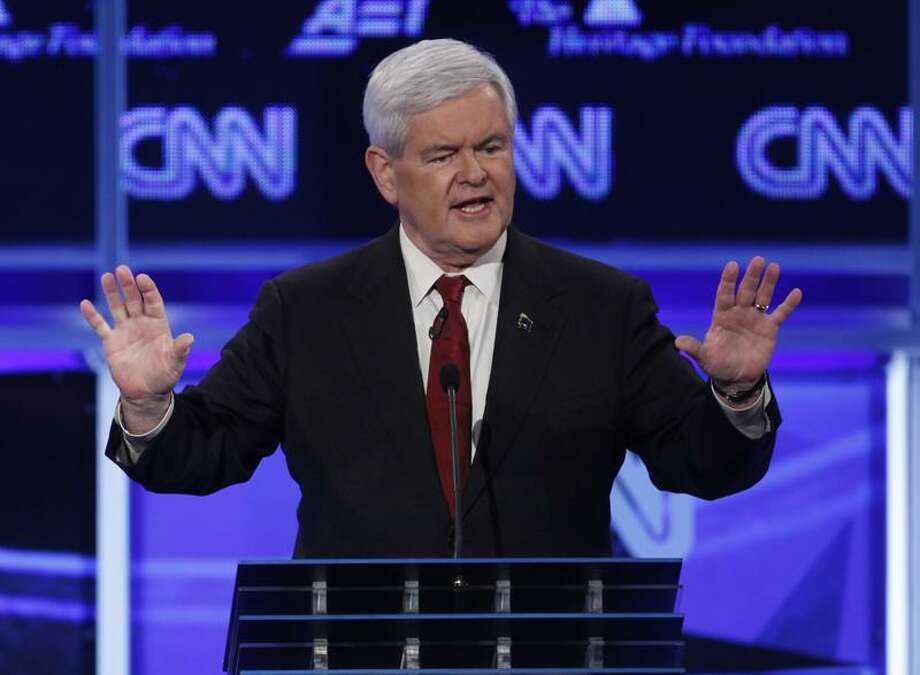 Former House Speaker Newt Gingrich during the Republican presidential debate on Tuesday, November 22, 2011 in Washington.   (AP Photo/Evan Vucci) Photo: AP / AP2011