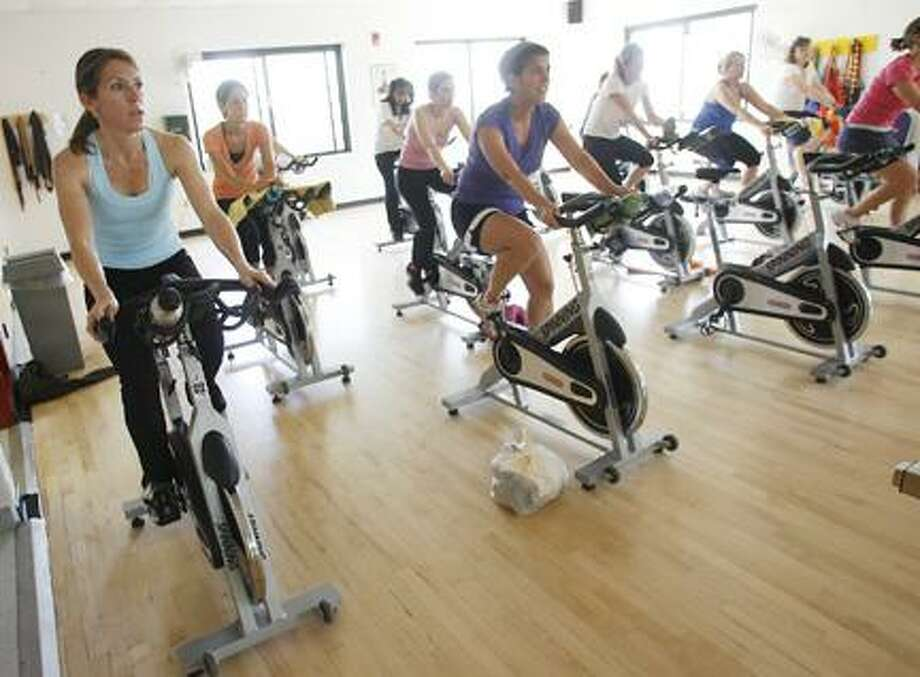 Photo by JOHN HAEGERRiders take part in the first of four spinning sessions to benefit the Ride for Missing and Exploited Children and the YMCA on Sunday, May 1, 2011 at the Greater Tri-Valley YMCA in Oneida.