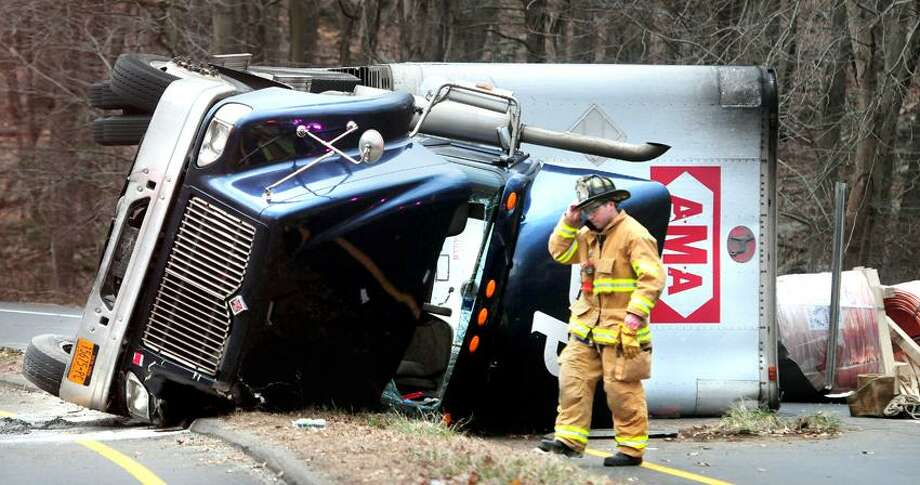 Emergency personnel respond to an overturned truck on the I-95 exit 57 on and off ramps in Guilford on 1/10/2012.Photo by Arnold Gold/New Haven Register   AG0434E