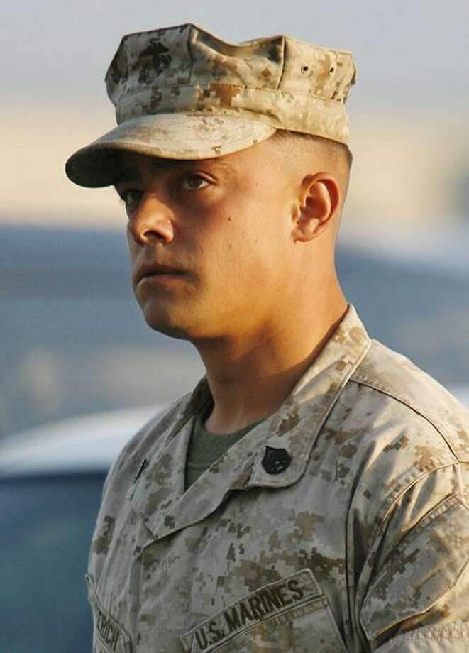 In this Aug. 30, 2007, file photo, Marine Corps Staff Sgt. Frank Wuterich arrives for his Article 32 Investigation Hearing at Camp Pendleton Marine Corps Base in San Diego County. Wuterich, the last defendant in the biggest and lengthiest criminal case against U.S. troops to arise from the Iraq war, stands trial this week, more than six years after his squad killed 24 Iraqi civilians in the town of Haditha, including unarmed women and children. Associated Press Photo: AP / AP2007