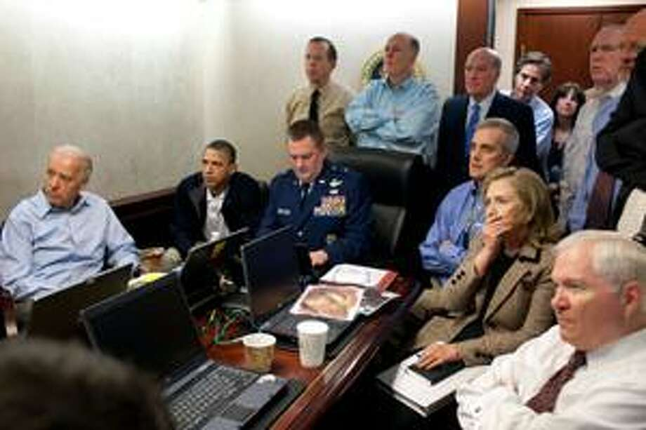In this image released by the White House and digitally altered by the source to diffuse the paper in front of Secretary of State Hillary Rodham Clinton, President Barack Obama and Vice President Joe Biden, along with with members of the national security team, receive an update on the mission against Osama bin Laden in the Situation Room of the White House, Sunday, May 1, 2011, in Washington. (AP Photo/The White House, Pete Souza) Photo: ASSOCIATED PRESS / AP2011