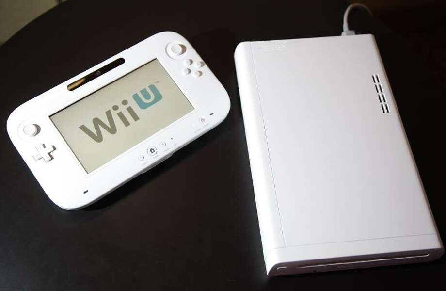 The new WiiU console is seen at the 2012 International CES tradeshow Tuesday in Las Vegas. Associated Press Photo: AP / AP