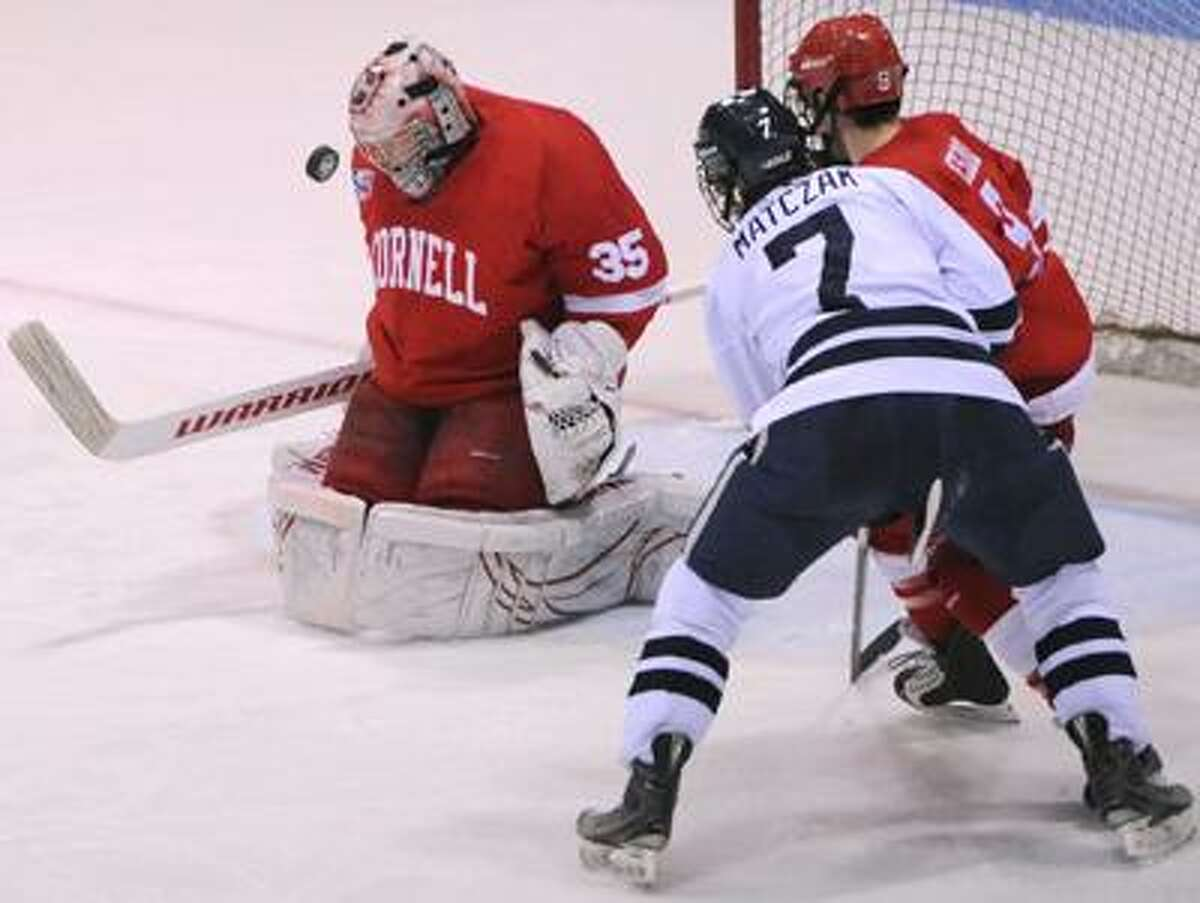 Cornell goalie Mike Garman stops a shot as Tyler Roeszler of Cornell puts a body on Mike Matczak of Yale during second period Ivy League Hockey Action Saturday 2/26/11 at Yale University's Ingalls Rink. Photo by Peter Hvizdak / New Haven Register February 26, 2011 ph2261 # Connecticut