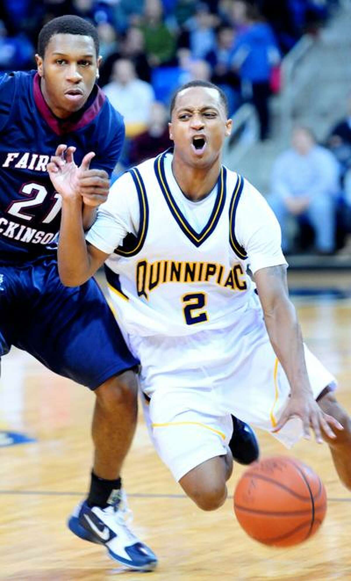 Dave Johnson (right) of Quinnipiac drives past DeShawn Dockery (left) of Fairleigh Dickinson in the first half on 2/26/2011.Photo by Arnold Gold/New Haven Register AG0404A