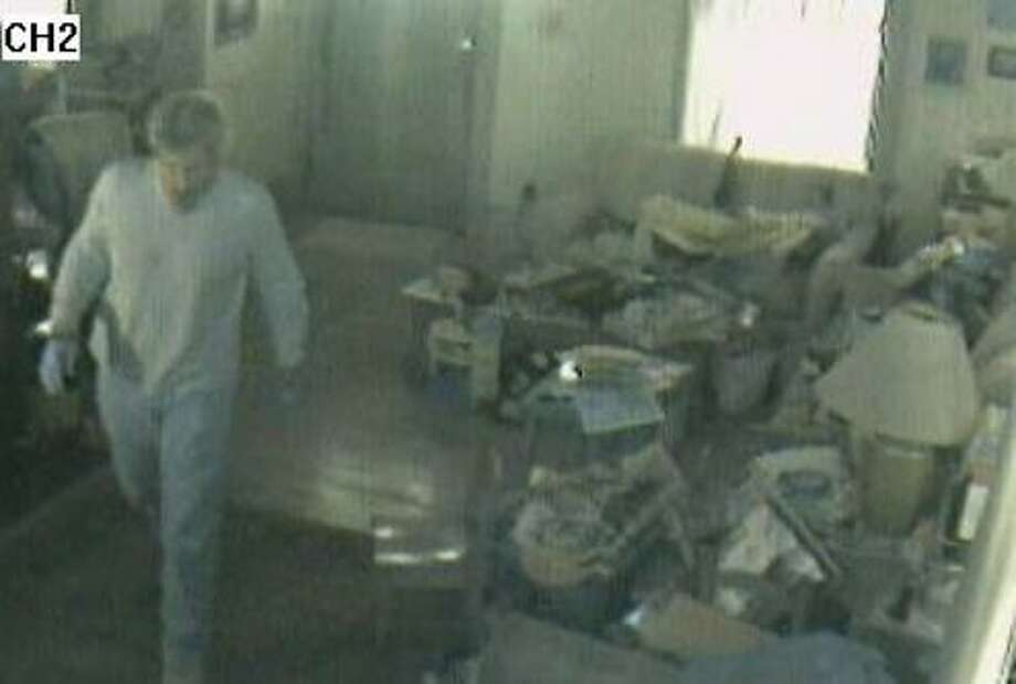 This photo, released by West Haven police, shows an alleged burglar in a Hine Street home on April 29.