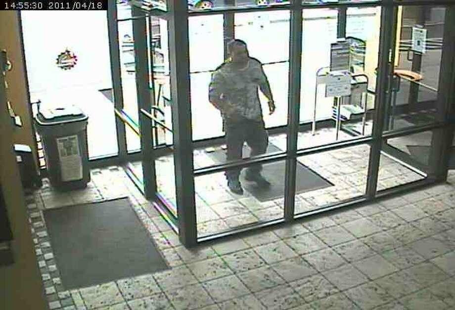 Surveillance photo of possible suspect.