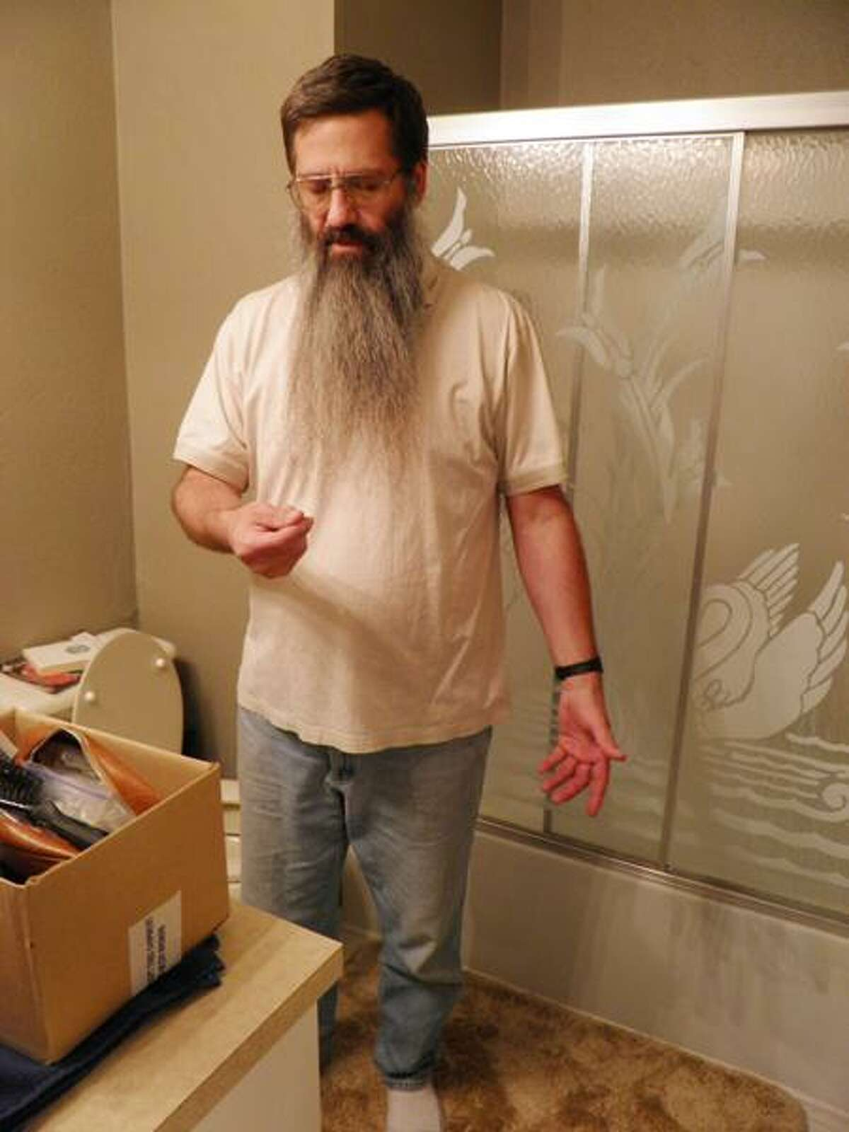 Gary Weddle is photographed minutes before he shaves his beard Sunday at his East Wenatchee, Wash., home. He kept a vow made nearly 10 years ago not to shave until Osama bin Laden was caught or proven killed. Associated Press