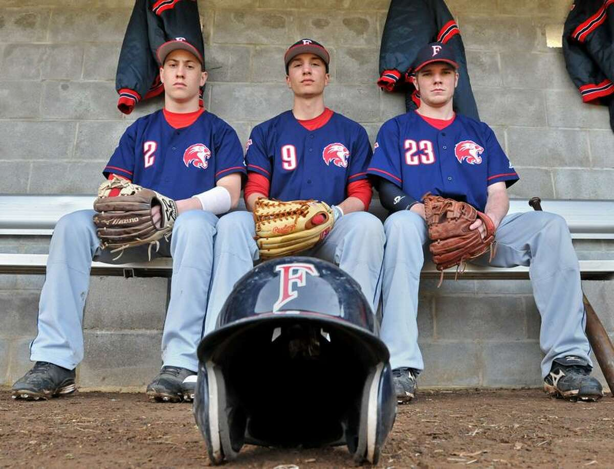 Milford--Foran baseball captains Stanley Olsson, Mike Deptulski and Ed Michaud. Photo by Brad Horrigan/New Haven Register-04.11.11.