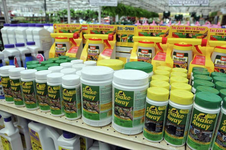 Shake-Away products on the shelves of Vinny's Garden Center in Wallingford. (Photo by Peter Casolino/New Haven Register)