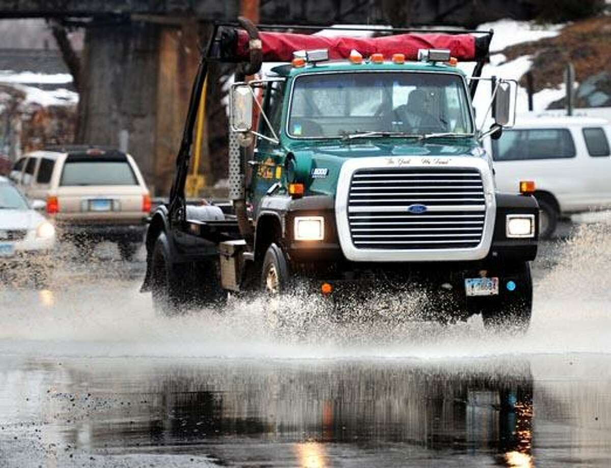A truck drives through standing water on Middletown Ave. in New Haven Friday. (Photo by Arnold Gold/New Haven Register)