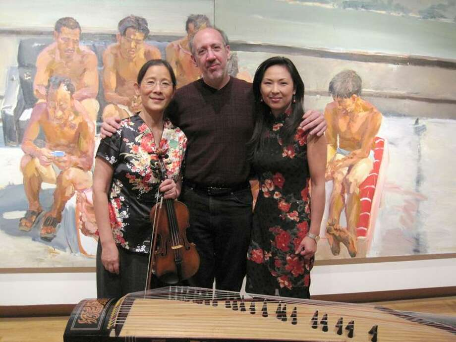 Orchestra New England composer-in-residence Mark Kuss, with soloists Hsiao-Mei Ku, left, and Jennifer Chang. (Orchestra New England)