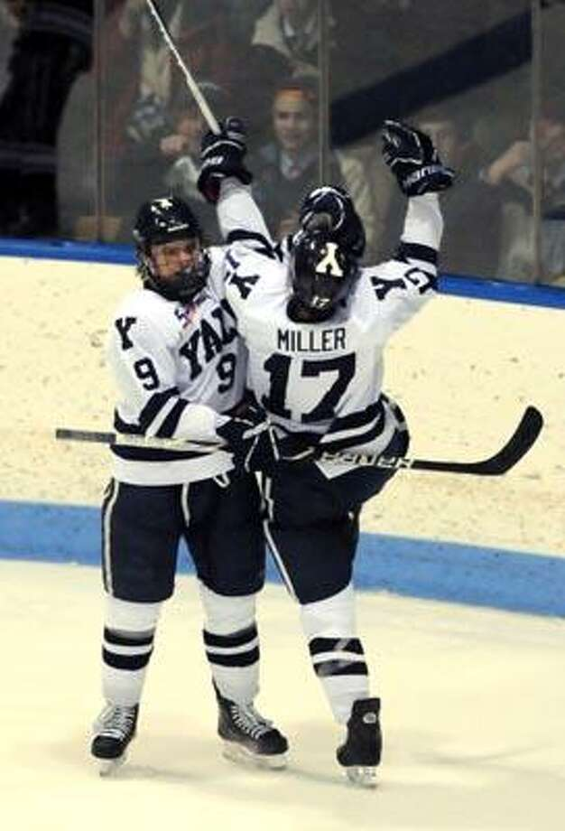 Colgate at Yale hockey (Ingalls Rink), 2nd period. Andrew Miller celebrates his goal with teammate Brian O'Neill left. Photo by Mara Lavitt/New Haven Register2/25/11