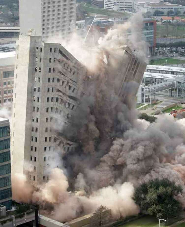 M.D. Anderson's Houston Main Building is imploded Sunday in Houston. Opened in 1952, the 20-story building was the regional headquarters for Prudential Insurance Company. Prudential sold the building in 1975. Associated Press Photo: AP / 2012 AP