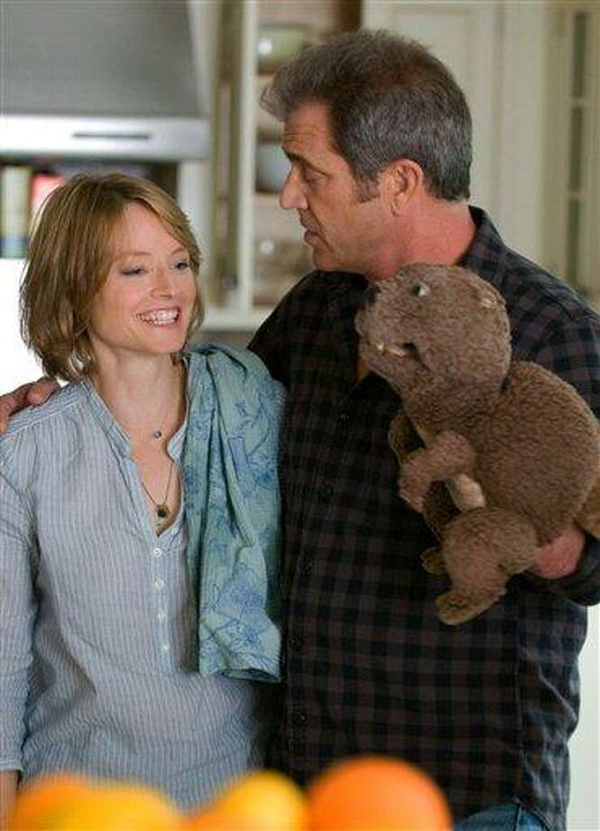 "In this film publicity image released by Summit Entertainment, actors Jodie Foster and Mel Gibson are shown during the filming of ""The Beaver."" Gibson has had more ugly scandals than hit movies in the past 5 years, but his longtime friend Jodie Foster still feels he's ""the most beloved actor"" in Hollywood. (AP Photo/Summit Entertainment, Ken Regan) Photo: AP / Copyright © 2009 Summit Entertainment LLC."