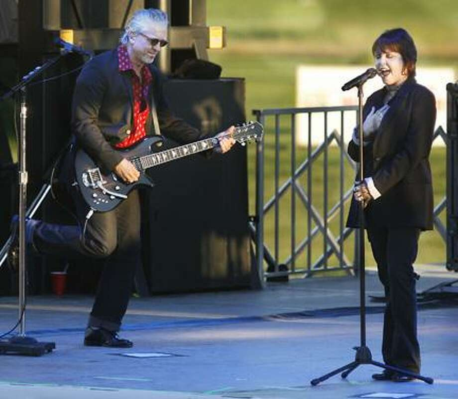 Dispatch Staff Photo by JOHN HAEGERPat Benatar and Neil Giraldo perform onstage at Vernon Downs on Thursday, June 30, 2011. Proceeds from the concert will benefit the CNY Food Bank.