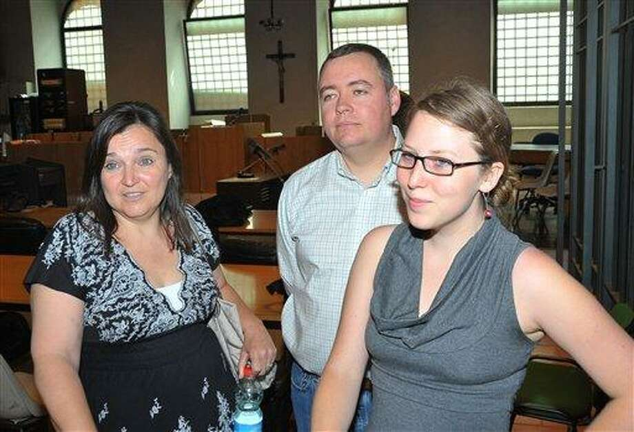 From left, Amanda Knox's mother, Edda Mellas, stepfather Chris Mellas, Amanda's friend Madison Paxton, talk to journalists during a pause of the appeal hearing, in Perugia, Italy, Monday, June 27, 2011. The first man convicted of killing a British student in Italy is to give evidence in the appeal hearing of American Amanda Knox and her former boyfriend against their murder convictions. Ivorian Rudy Hermann Guede is serving a 16-year-prison sentence for the 2007 murder of Meredith Kercher, a British student who was stabbed to death in the apartment she shared with Knox. (AP Photo/Stefano Medici) Photo: AP / AP