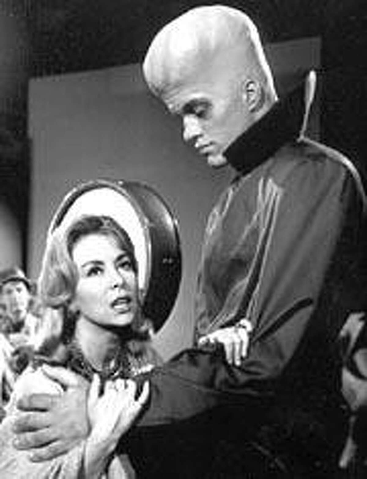 """The episode """"To Serve Man"""" on Syfy's """"Twilight Zone"""" marathon (see below). We'd tell you what the woman is saying, but it's the shocker ending of the story."""
