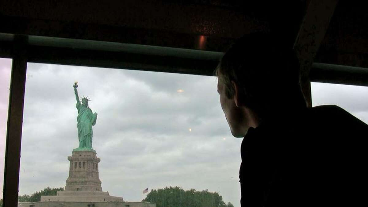 Pelosi's husband, Michiel Vos, looks out at the Statue of Liberty.