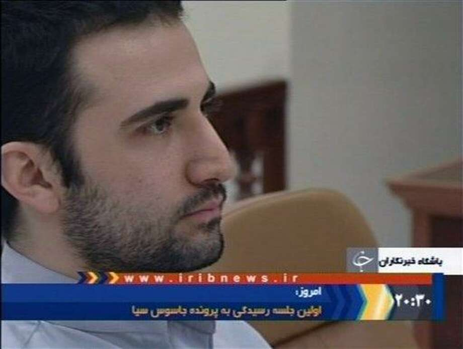 A Dec. 27, 2011 file photo of a video frame grab image made from the Iranian broadcaster IRIB TV shows U.S. citizen Amir Mirzaei Hekmati, accused by Iran of spying for the CIA, in Tehran's revolutionary court, in Iran. An Iranian court has convicted an American man of working for the CIA and sentenced him to death, state radio reported Monday. Associated Press Photo: AP / IRIB