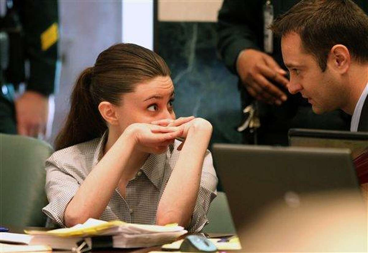 Casey Anthony talks to an unidentified man during her murder trial at the Orange County Courthouse Thursday, June 30, 2011 in Orlando, Fla. Casey Anthony, 25, has plead not guilty in the death of her daughter, Caylee, and could face the death penalty if convicted of that charge. (AP Photo/Red Huber, Pool)