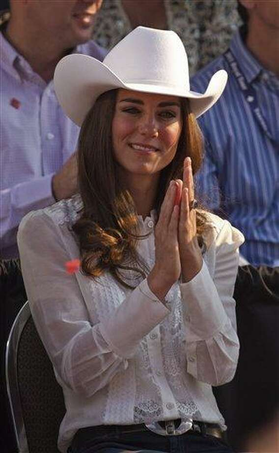 In this July 8, 2011 file photo, Kate, the Duchess of Cambridge, watches the Calgary Stampede parade in Calgary, Canada as the Royal couple continue their Royal Tour of Canada. The Duchess of Cambridge is turning 30 on Monday, Jan. 9, 2011 - but royal fans expecting a lavish birthday bash to mark the milestone will be disappointed. Associated Press Photo: AP / AP