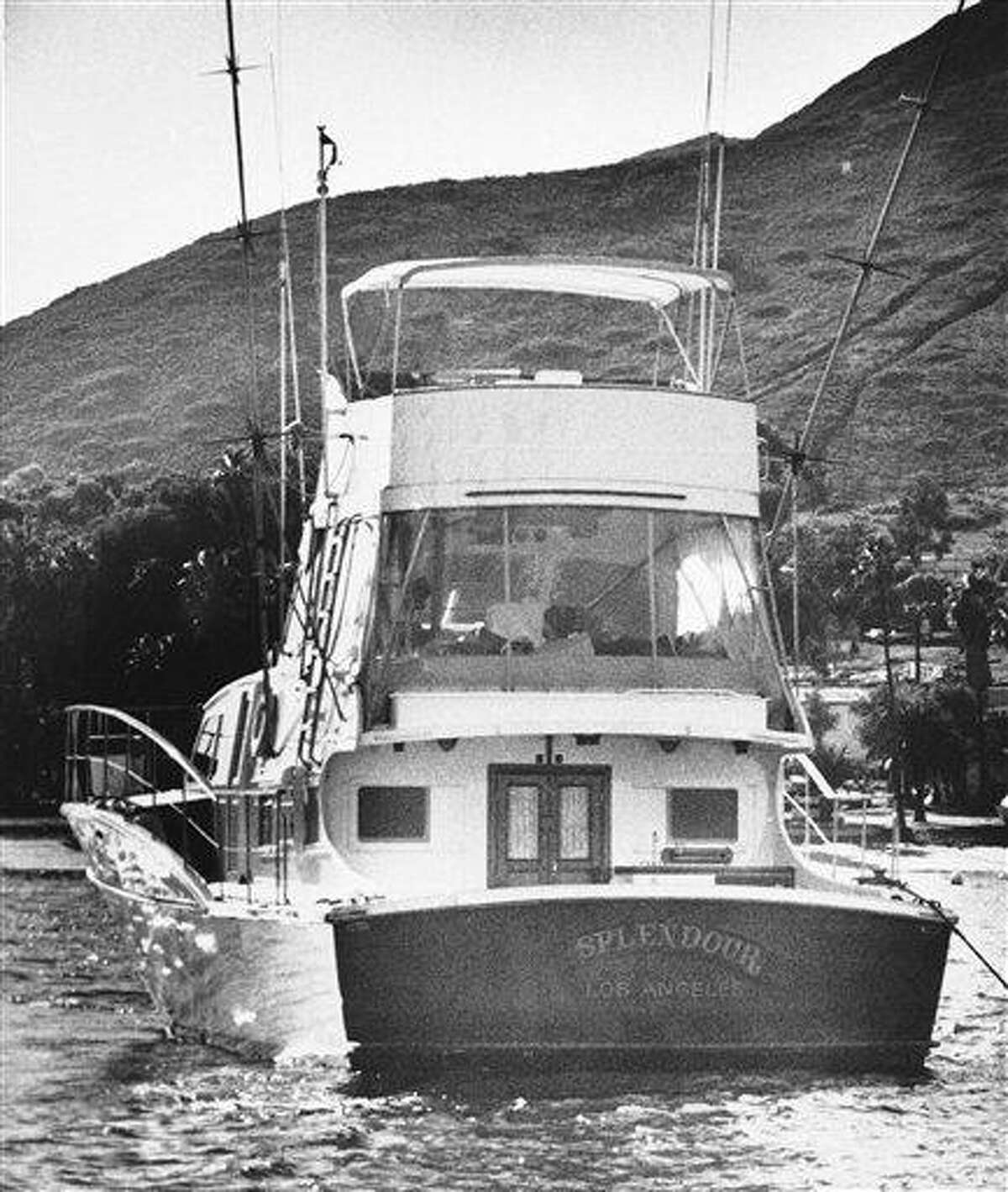 """The 55-foot yacht """"Splendour,"""" belonging to actor Robert Wagner and his wife, actress Natalie Wood, sits in the waters off Catalina Island in Santa Catalina, Calif., near the site where Harbor Patrol personnel and lifeguards discovered the body of Wood, an apparent drowning victim, Nov. 29, 1981. Los Angeles sheriff's homicide detectives are taking another look at Wood's 1981 drowning death based on new information, officials announced Thursday, Nov. 17, 2011. (AP Photo/Harrington, File)"""
