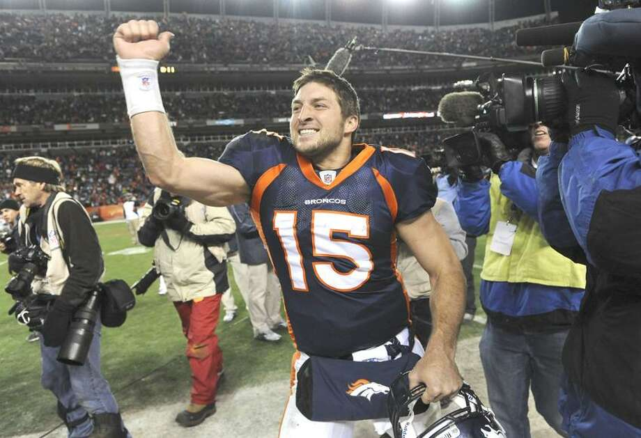 Denver Broncos quarterback Tim Tebow (15) celebrates after beating the Pittsburgh Steelers 29-23 in overtime of an NFL wild card playoff football game Sunday, Jan. 8, 2012, in Denver.  (AP Photo/Chris Schneider) Photo: AP / CHRIS SCHNEIDER