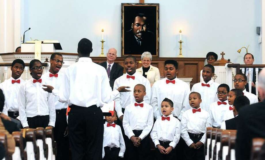 Members of the Unity Boy's Choir honor the Rev. Dr. Martin Luther King Jr. in song during the 26th annual tribute held by the West Haven Black Coalition at the First Congregational Church on the Green in West Haven.    Peter Casolino/Register