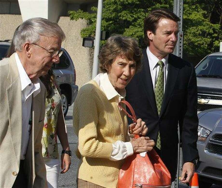 Former Sen. John  Edwards, right, leads his mother, Bobbie Edwards, center, and father, Wallace Edwards, into the Federal Courthouse in Greensboro, N.C. Tuesday.   Associated Press Photo: AP / 2012 The News & Observer